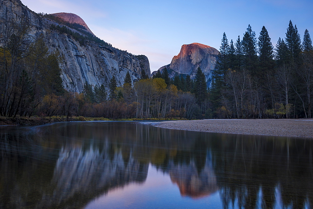 Half Dome mountain catches the last glow of sunset reflected in the Merced River in Yosemite National Park, UNESCO World Heritage Site, California, United States of America, North America - 1225-1206