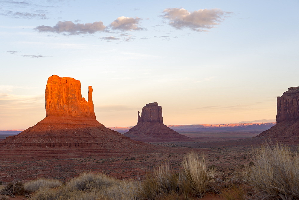 The giant sandstone buttes glowing pink at sunset in Monument Valley Navajo Tribal Park on the Arizona-Utah border, United States of America, North America - 1225-1219