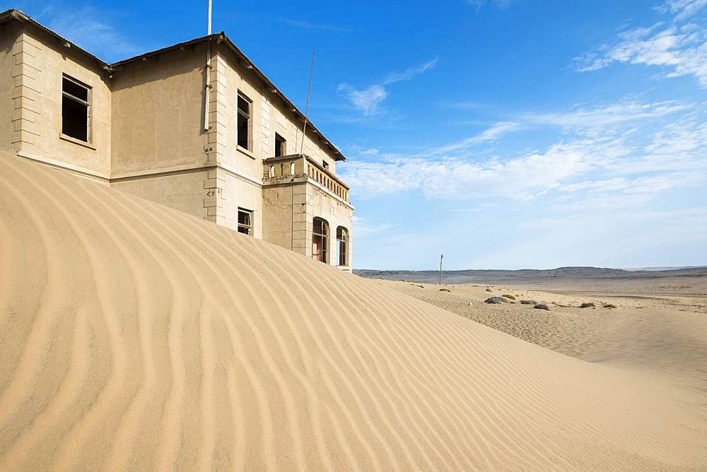 A building in the abandoned diamond mining ghost town of Kolmanskop, Namibia, Africa - 1225-1239