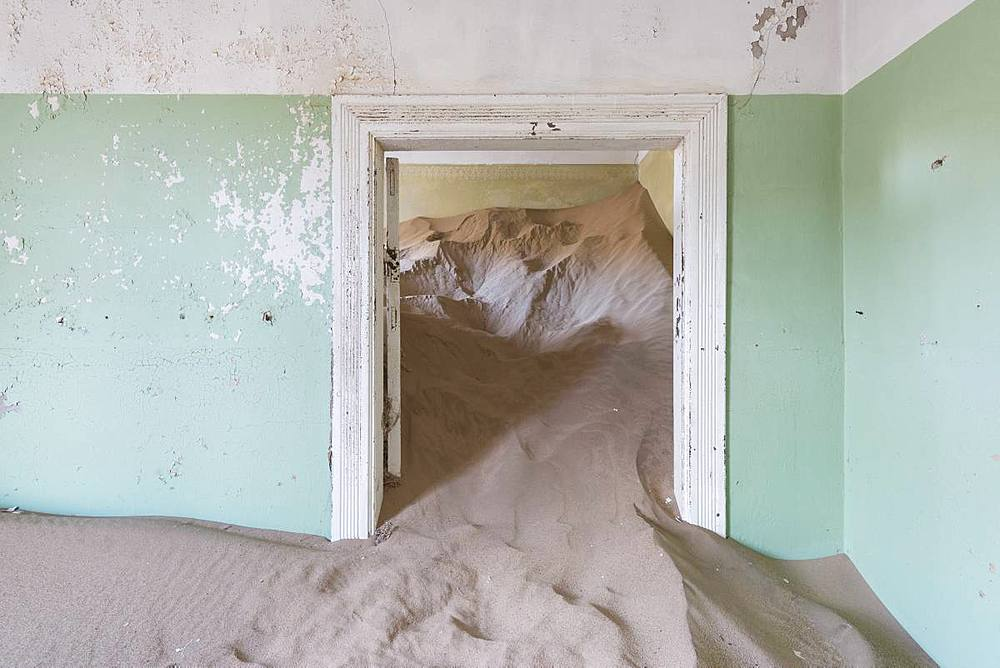 The interior of a building in the abandoned diamond mining ghost town of Kolmanskop, Namibia, Africa - 1225-1241