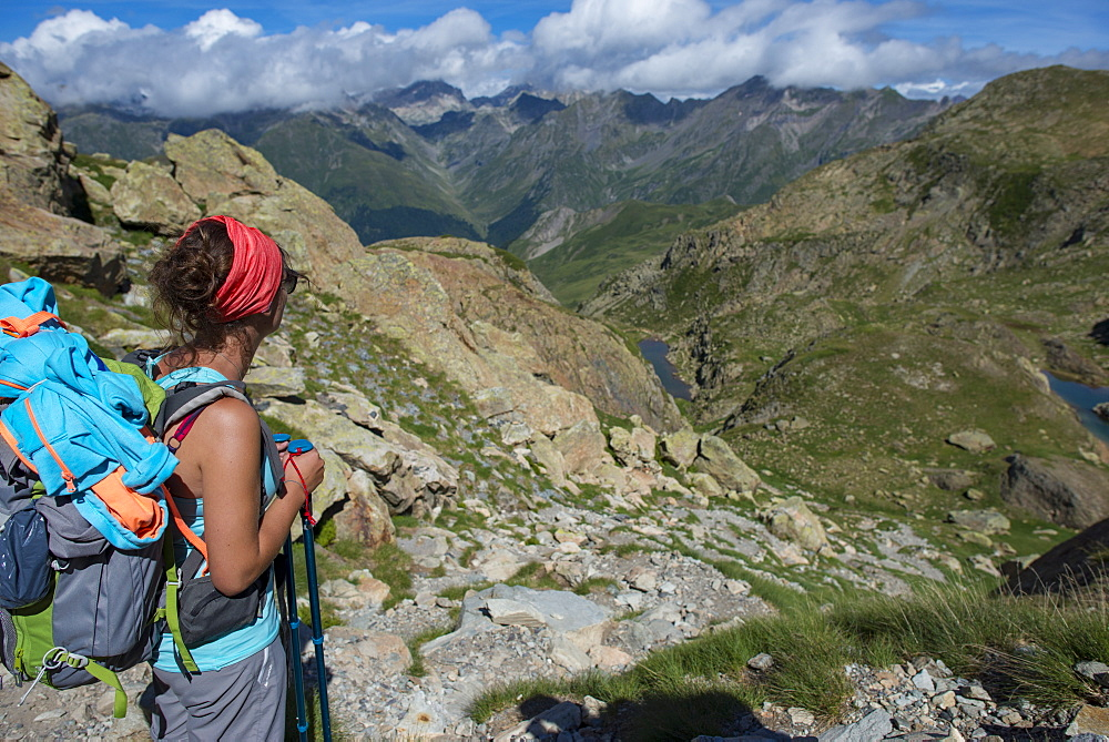 A hiker looks out at the Pyrenees mountains from the top of Col Peyreget while hiking the GR10 trekking trail, Pyrenees Atlantiques, France, Europe - 1225-1248