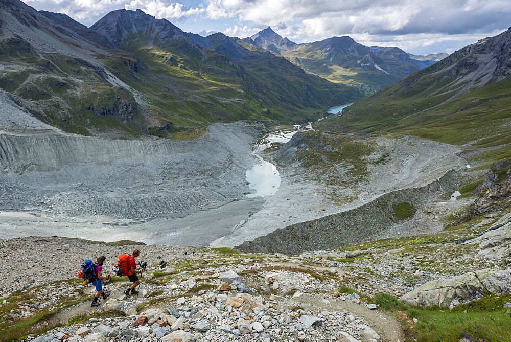 hikers beside the Moiry glacier on the Walkers Haute Route from Chamonix to Zermatt - 1225-1269