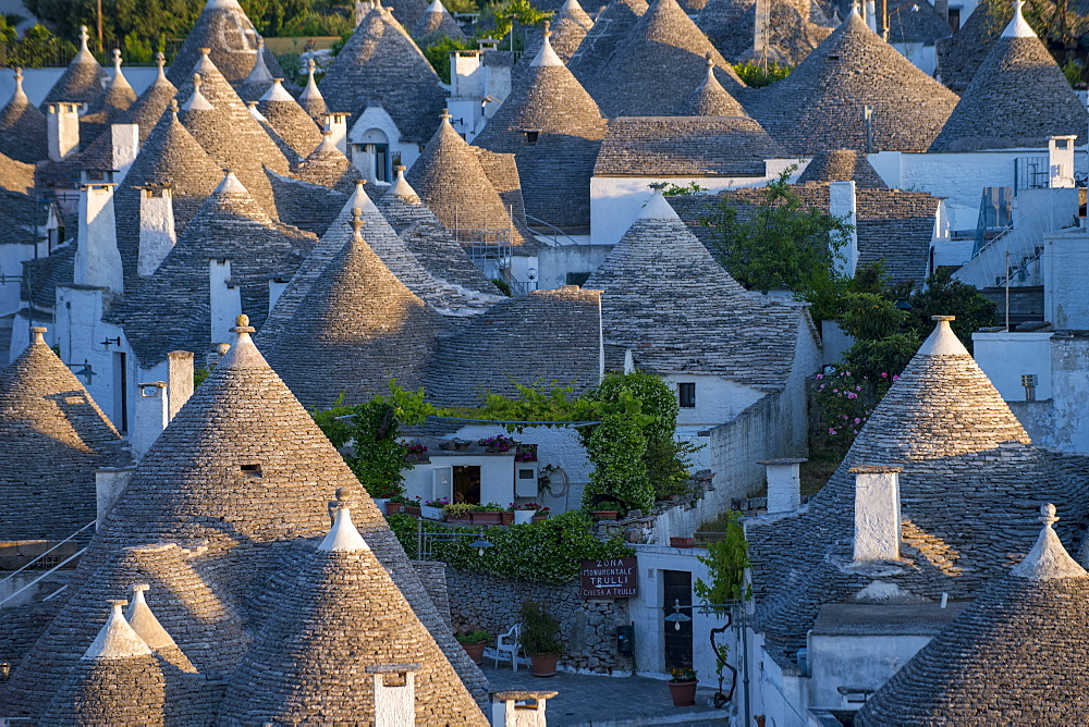 Distinctive conical rooftops of Trulli houses in the town of Alberobello - 1225-1289