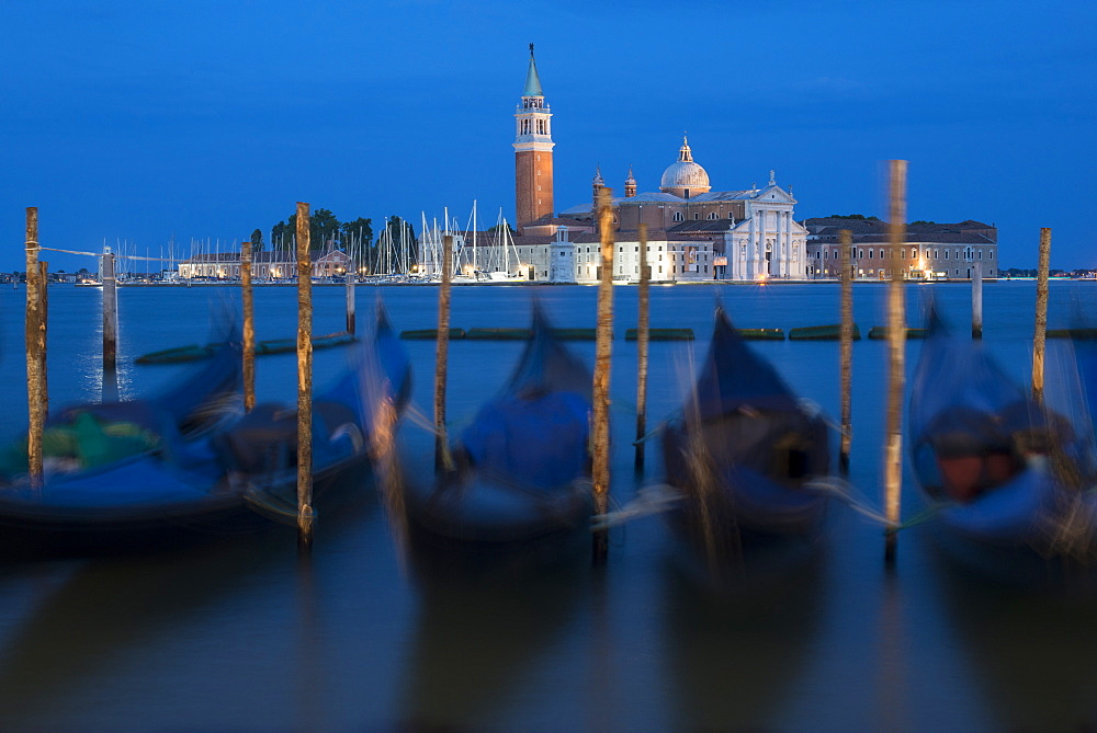 Gondolas near San Marco moored to wooden posts at twilight with San Giorgio in the distance - 1225-1299