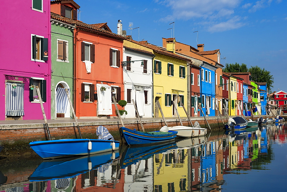 Colourful Burano houses and boats reflected in a canal - 1225-1301