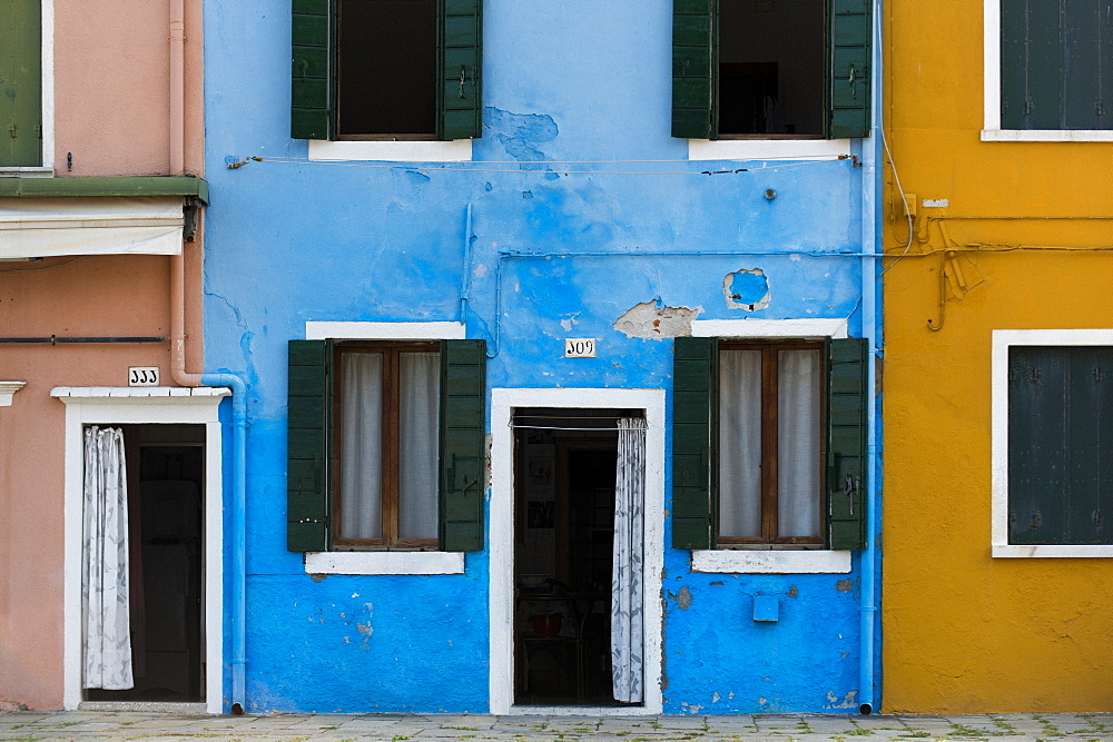 Exterior facades, doors and windows of colourful buildings and walls on the island of Burano, Venice, Veneto, Italy, Europe - 1225-1303