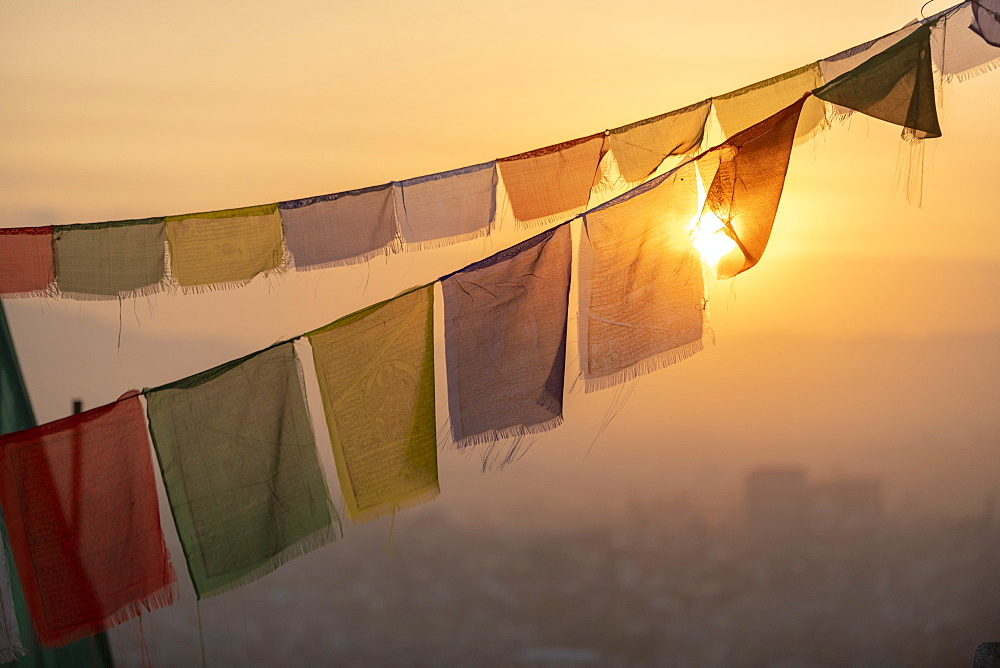 Prayer flags at Swayambhunath (Monkey Temple) in front of the city at sunrise, Kathmandu Valley, Nepal, Asia - 1225-1327