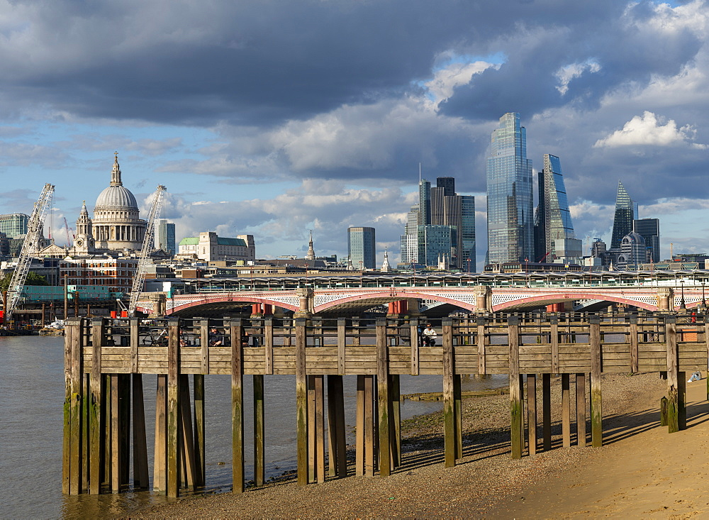 St. Pauls Cathedral and the City of London above old wooden pilings on the Southbank of the River Thames, London, England, United Kingdom, Europe