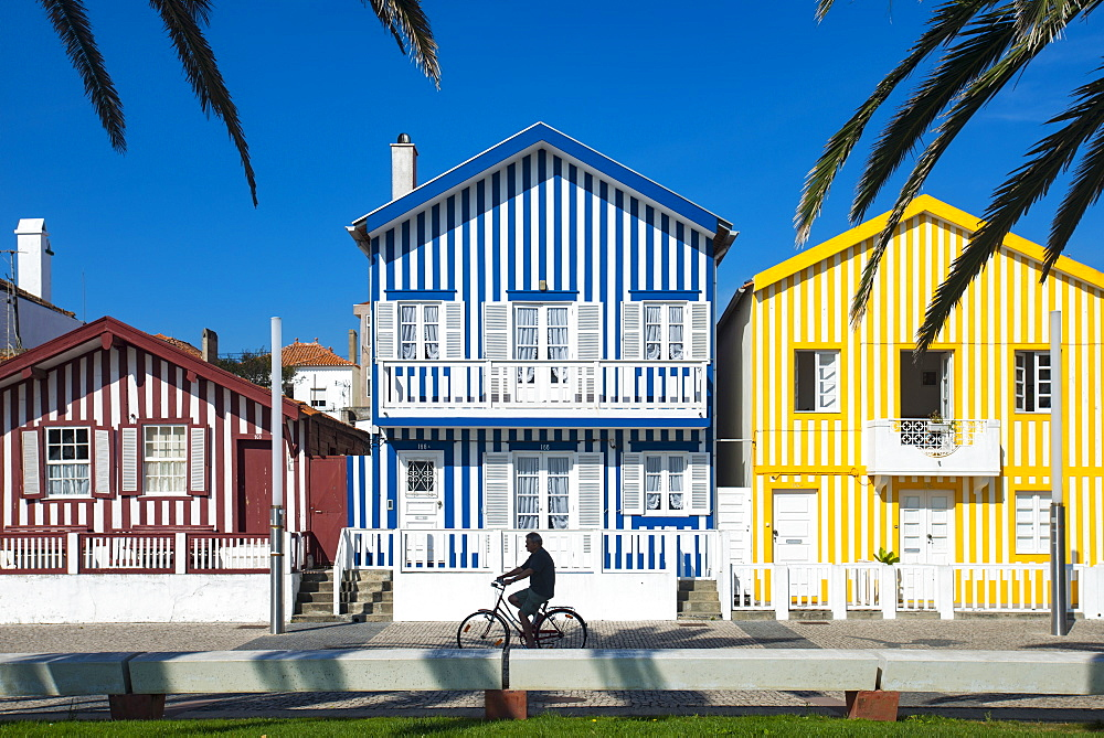 Colourful stripes decorate traditional beach house style on houses in Costa Nova, Portugal, Europe