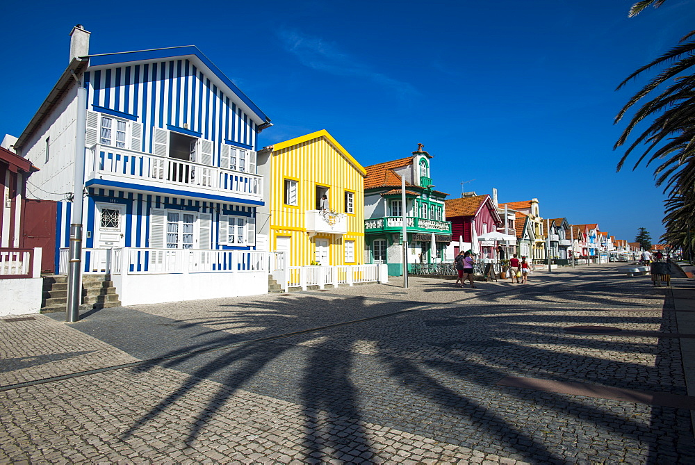 Colourful stripes decorate traditional beach house style on houses in Costa Nova, Portugal, Europe - 1225-182