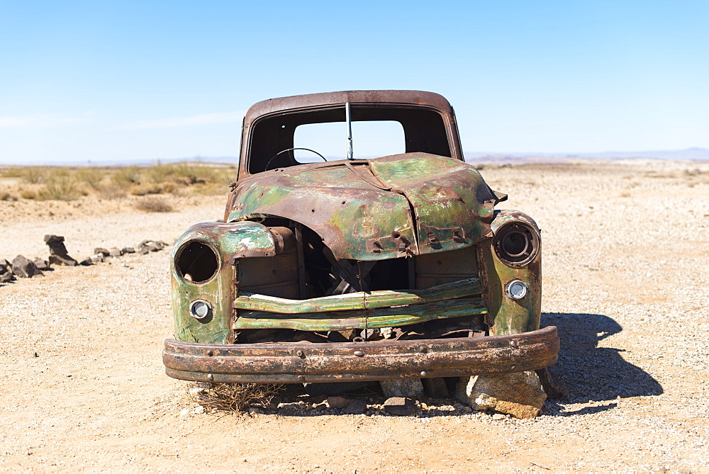 A rusty abandoned car in the desert near Aus in southern Namibia, Africa