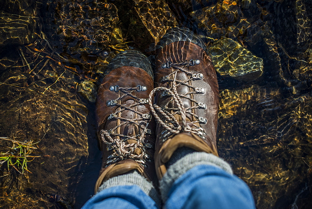 Boots in a stream, Cumbria, England, United Kingdom, Europe