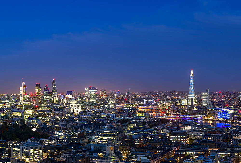 A night-time view of London and the River Thames from the top of Centre Point tower across to The Shard, St. Paul's Cathedral and City skyline, London, England, United Kingdom, Europe