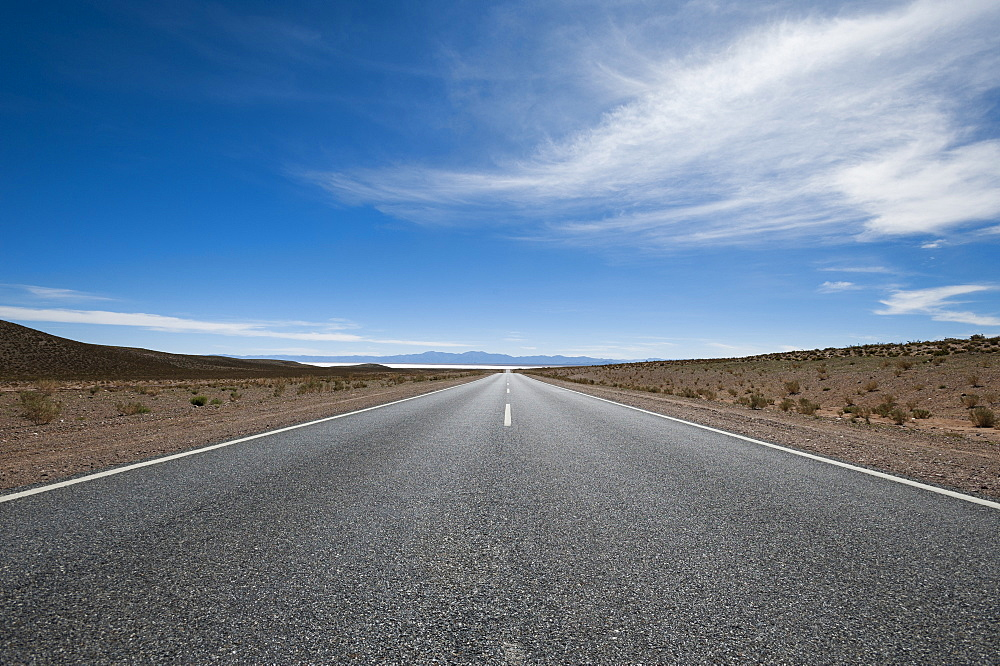 Road leading towards the Salinas Grandes (salt flats) near Purmamarca, Argentina, South America