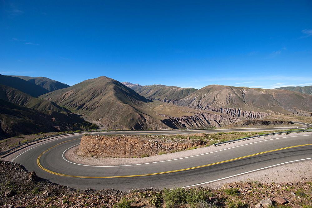 Road leading towards the Salinas Grandes (salt flats) near Purmamarca, Argentina, South America