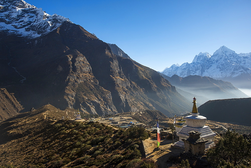 A view from Thame monastery in Nepal looking down the Thame valley with Thermserku and Kantega peaks in the distance.