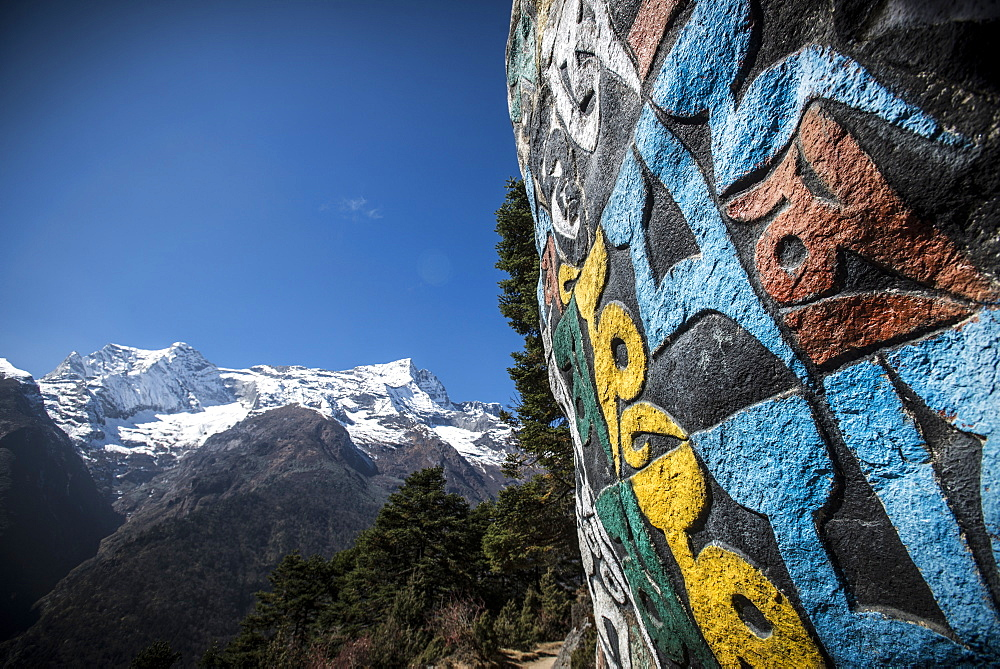 A Mani wall, inscribed with an ancient Buddhist mantra decorates the trail to Everest Base Camp, Nepal, Himalayas, Asia