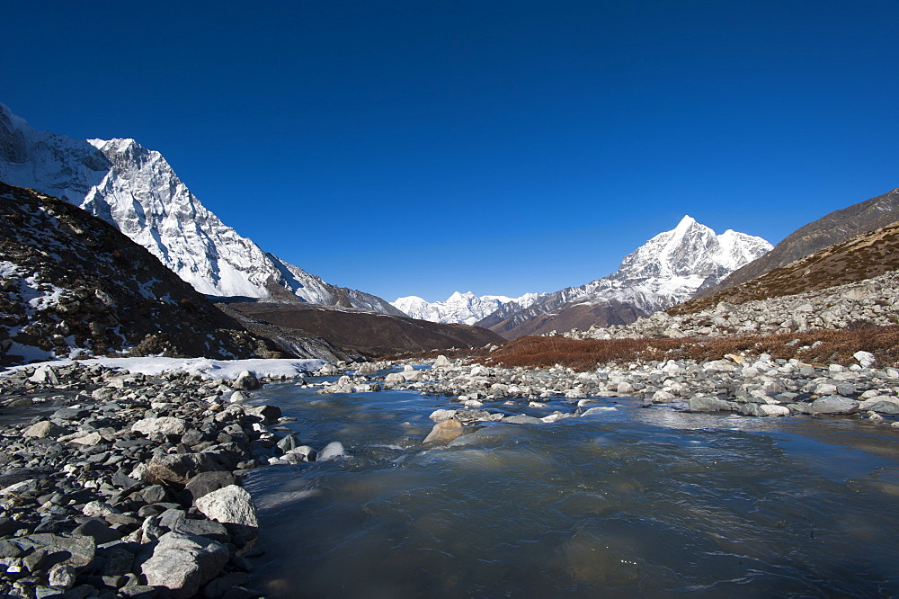 Icy meltwater flows down the Chekhung valley with views of Ama Dablam to the left and Taboche to the right, Khumbu Region, Nepal, Himalayas, Asia - 1225-582