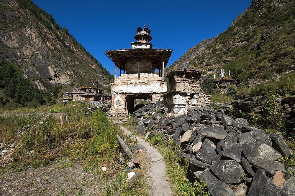 Mani stones and a Kani are the gateway to a small village in the Kagmara valley in Dolpa, a remote region of Nepal, Himalayas, Asia