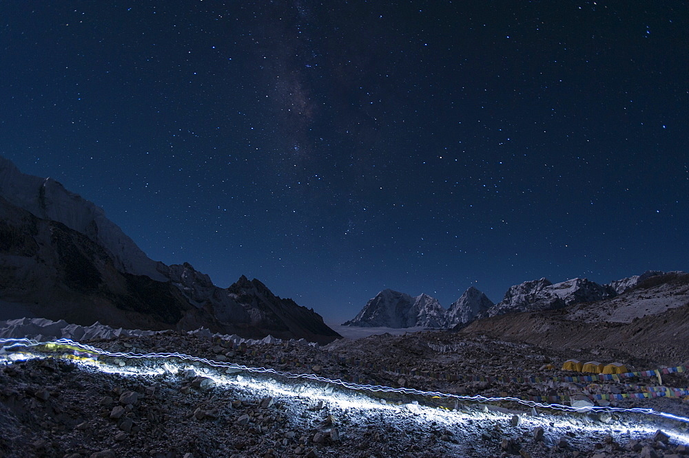 Departure of the Sherpas; their head-torches leave trails of light across the glacier on their way to Everest in Nepal