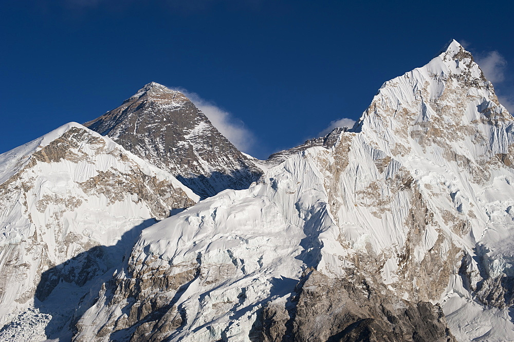 The massive black pyramid summit of Mount Everest seen from Kala Patar with Nuptse the other peak to the right, Khumbu Region, Nepal, Himalayas, Asia