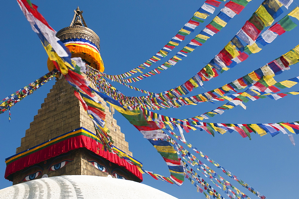 Bouddha (Boudhanath) (Bodnath) in Kathmandu is covered in colourful prayer flags, Kathmandu, Nepal, Asia