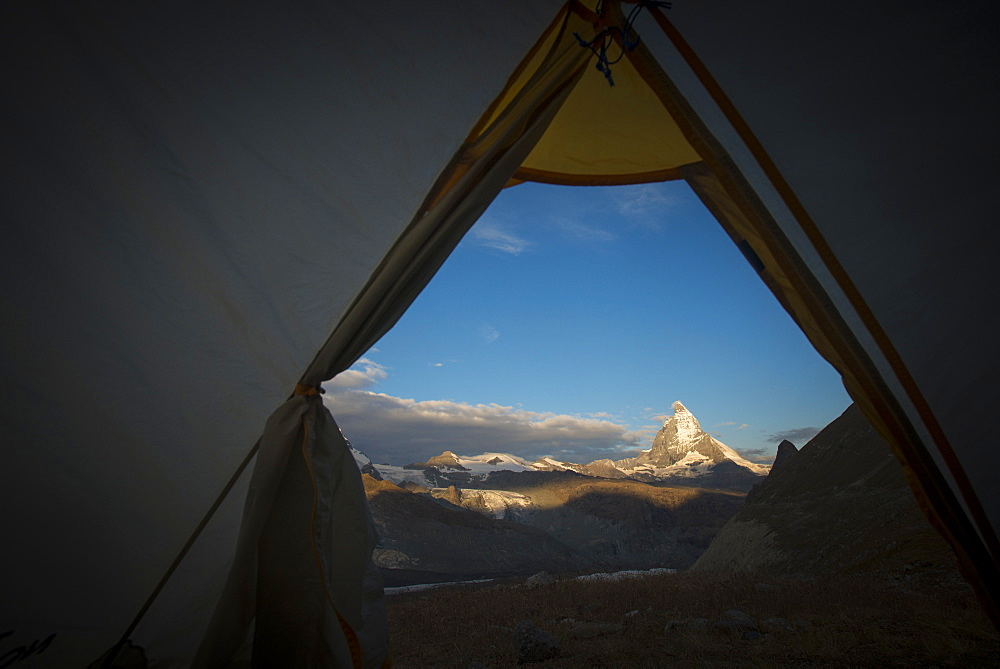 A view of the Matterhorn in the Swiss Alps from a tent while camped beside the Gorner glacier, Zermatt, Valais, Switzerland, Europe