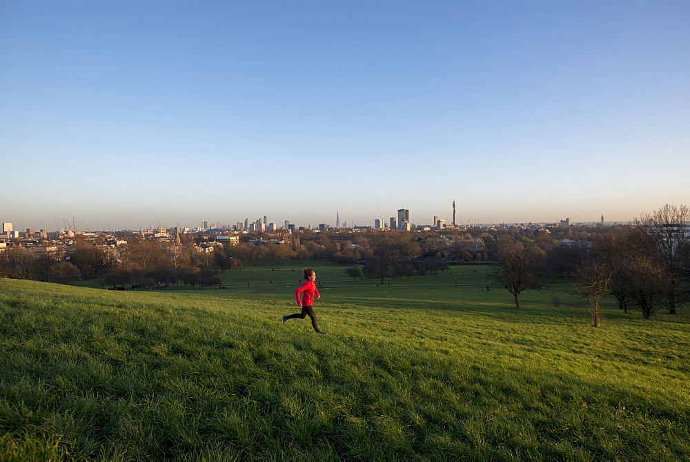 Lizzy Hawker, a world record holding extreme athlete, training on Primrose Hill, London, England, United Kingdom, Europe