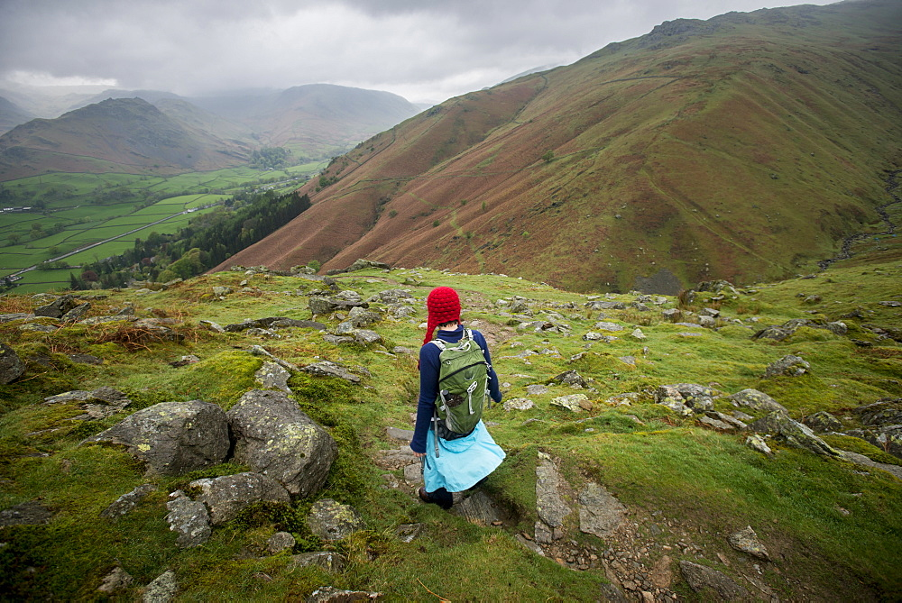 Walking towards Grasmere from Alcock Tarn in The Lake District in England