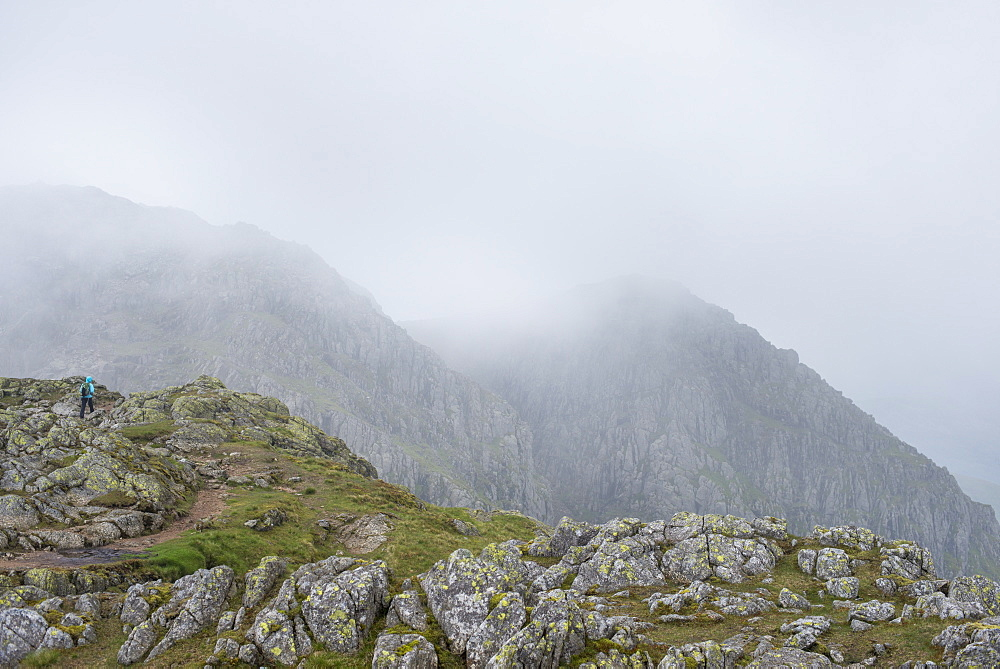 Walking through Crinkle Craggs at the head of the Great Langdale valley on a misty day, Lake District National Park, Cumbria, England, United Kingdom, Europe