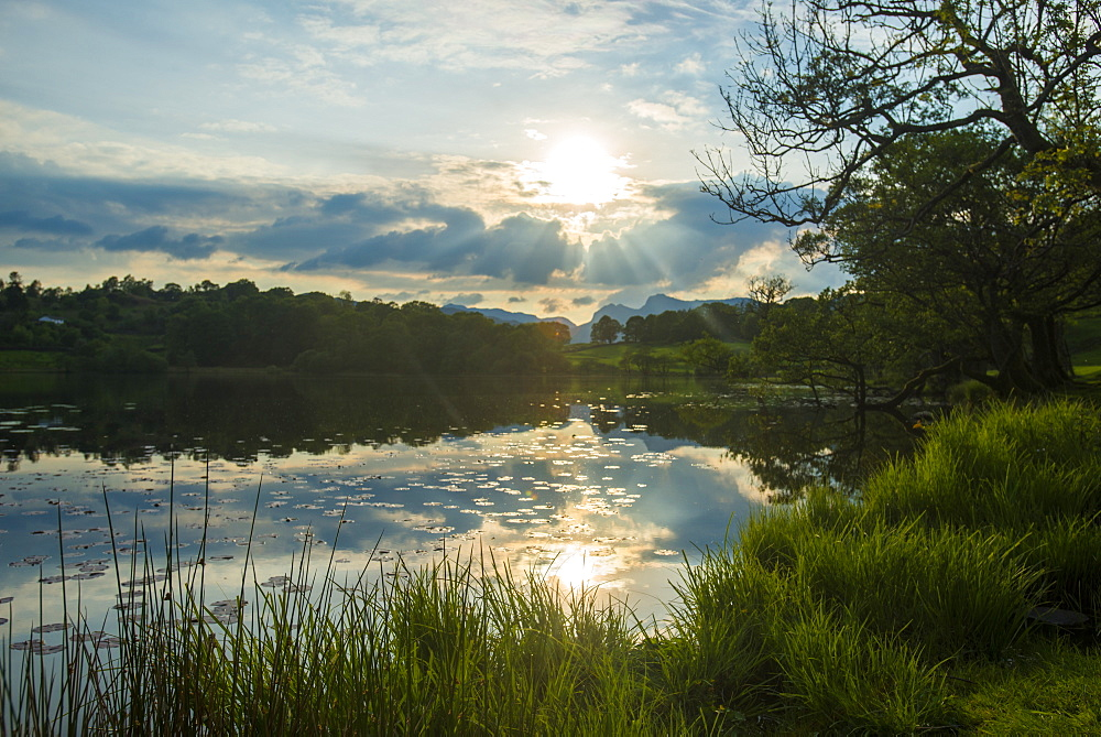 Sunset at Loughrigg Tarn near Ambleside in The Lake District in England