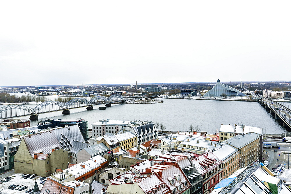 View over Riga Old Town city centre and Daugava River, with snow covered rooftops, UNESCO World Heritage Site, Latvia