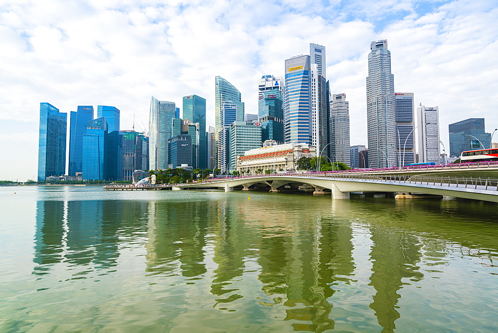 Singapore skyline, financial district skyscrapers with the Fullerton Hotel and Jubilee Bridge in the foreground by Marina Bay, Singapore, Southeast Asia, Asia