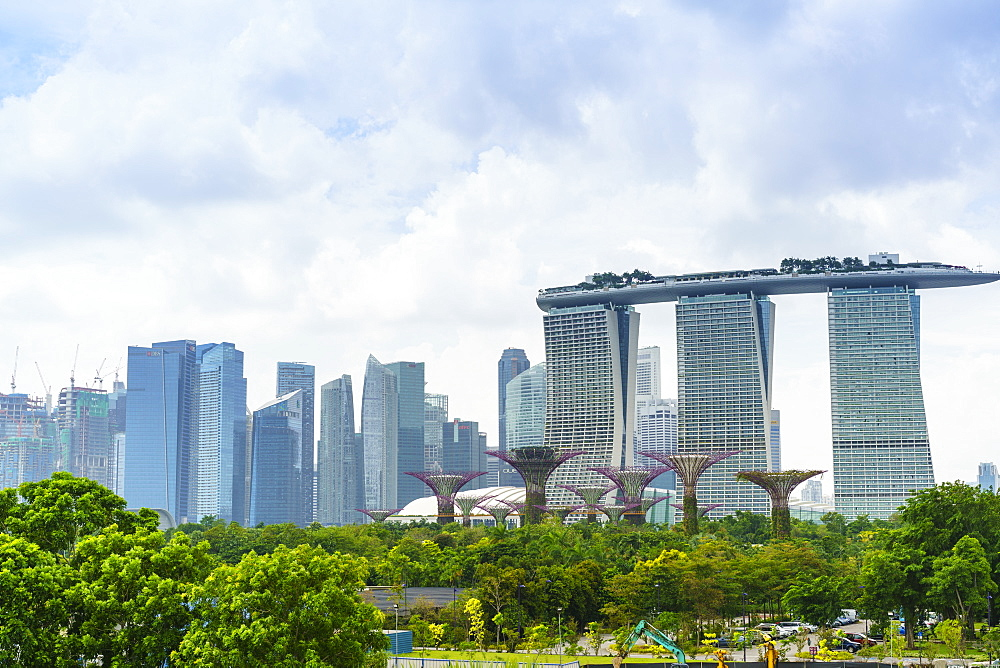 View over the Gardens by the Bay to the three towers of the Marina Bay Sands Hotel and city skyline beyond, Singapore, Southeast Asia, Asia