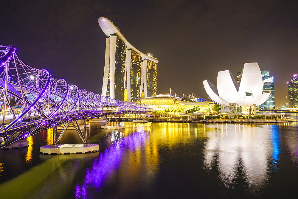 Helix Bridge, Marina Bay Sands and ArtScience Museum illuminated at night, Marina Bay, Singapore, Southeast Asia, Asia