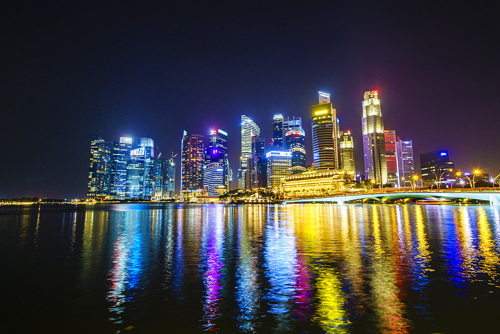 Singapore skyline from Marina Bay at night with the Fullerton Hotel and Jubilee Bridge, Singapore, Southeast Asia, Asia