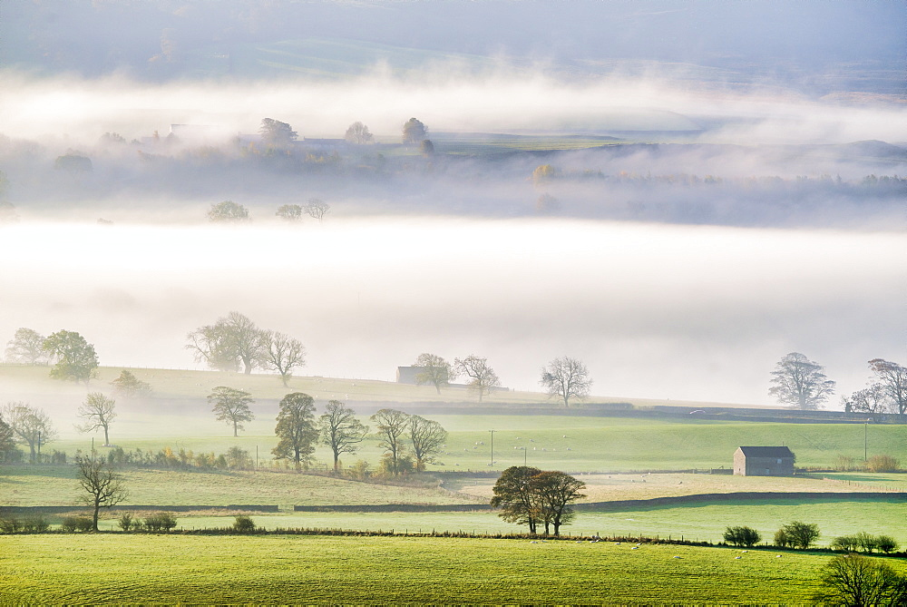 Mist rising over East Halton and Embsay in Lower Wharfedale, North Yorkshire, Yorkshire, England, United Kingdom, Europe
