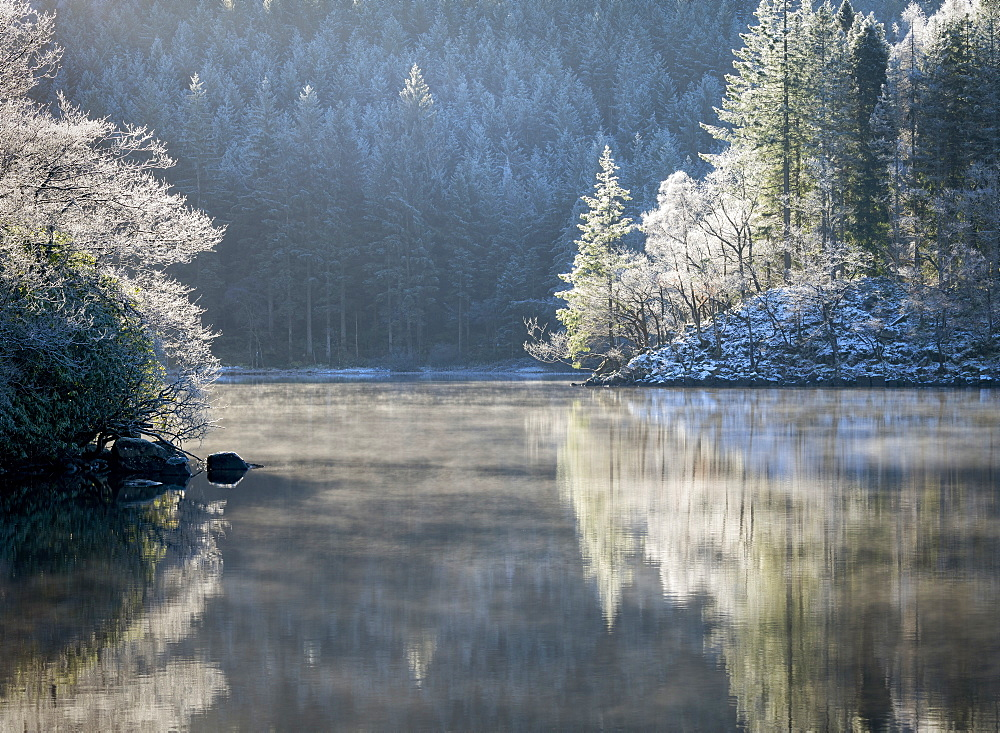 A hoar frost and transient mist over Loch Ard in the Loch Lomond and the Trossachs National Park in mid-winter, Stirling District, Scotland, United Kingdom, Europe