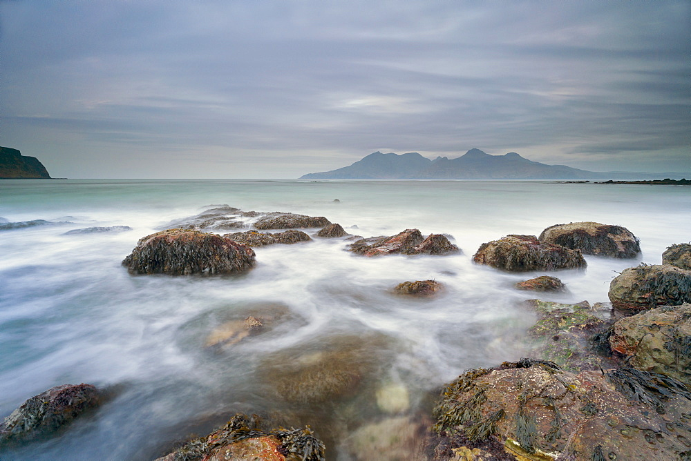 The Isle of Rhum from Laig Bay, Cleadale, Isle of Eigg, Small Isles, Inner Hebrides, Scotland, United Kingdom, Europe