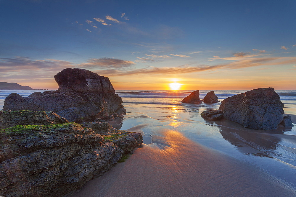 Sun setting over Sango Bay beach in mid-summer, Durness, Scotland.