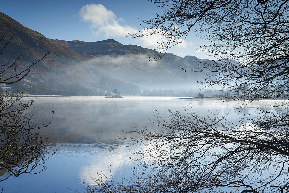 Dawn light and transient sunlit mist over Wall Holm Island on Ullswater, Lake District National Park, UNESCO World Heritage Site, Cumbria, England, United Kingdom, Europe - 1228-234