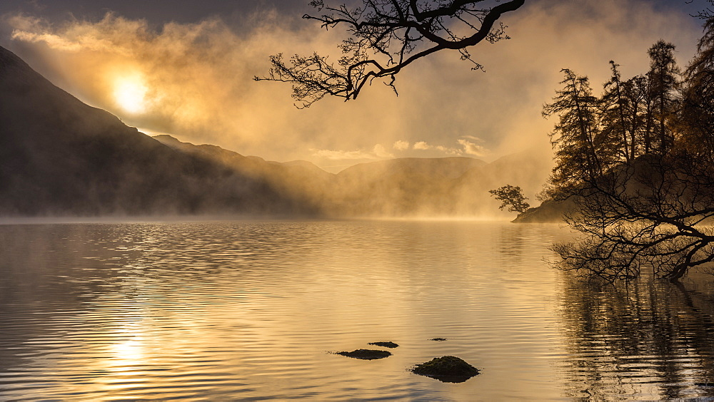 Dawn light and clearing mist over Glenridding and Ullswater, Cumbria, UK
