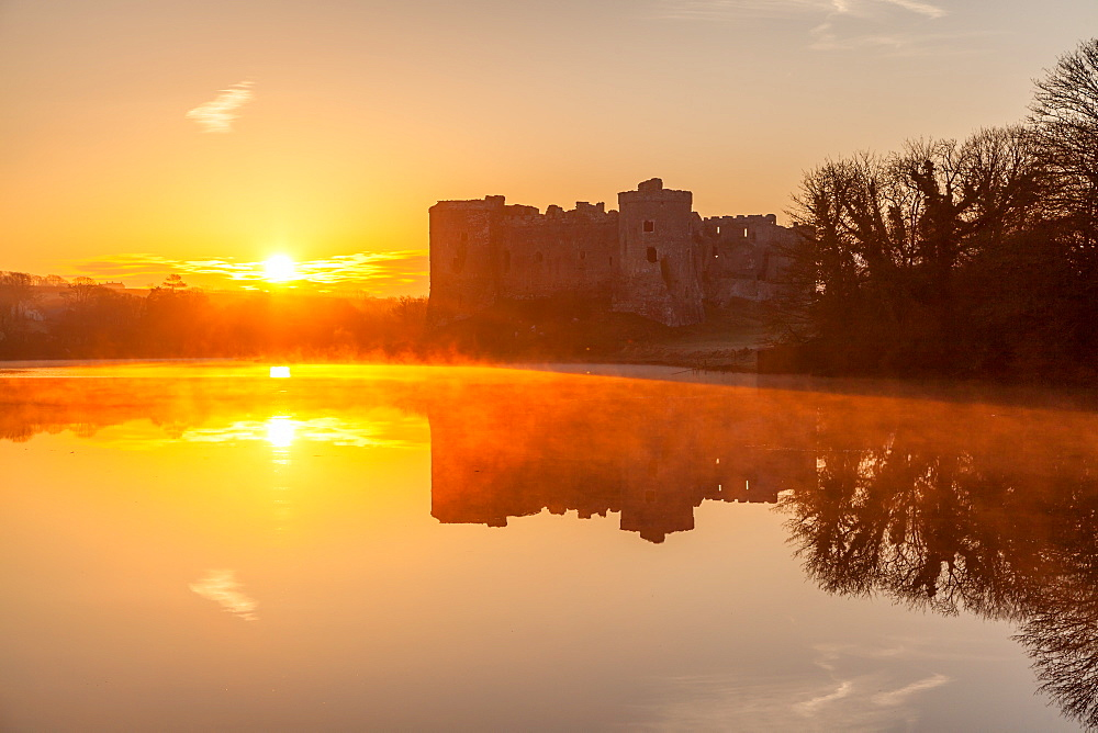 Carew Castle sunrise, Pembrokeshire, Wales, United Kingdom, Europe - 1230-1
