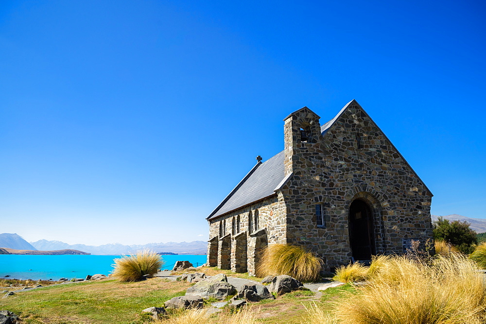 Church of the Good Shepherd, an old church overlooking turquoise blue Lake Tekapo, Tekapo, Mackenzie Distrtict, Canterbury Region, South Island, New Zealand, Pacific