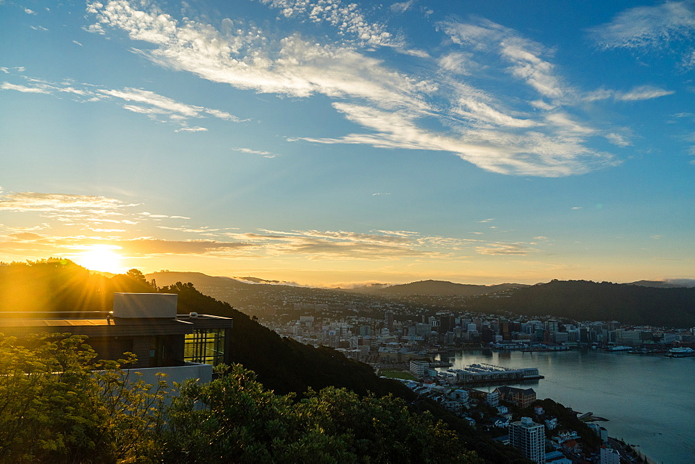 The sun sets over a new home atop Mount Victoria in Wellington, North Island, New Zealand, Pacific