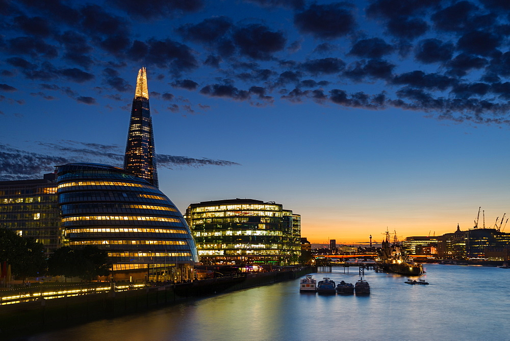 Dusk settles over London after sunset along the River Thames, with the Shard, London, England, United Kingdom, Europe