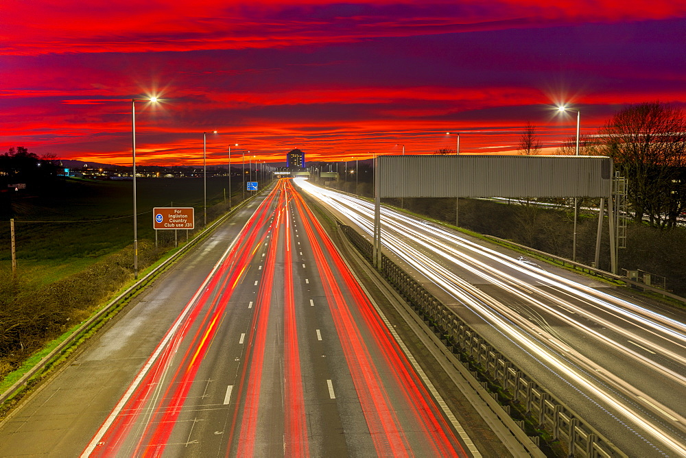 Red sky sunset, traffic light trails, M8 Motorway, Scotland, United Kingdom, Europe - 1237-343
