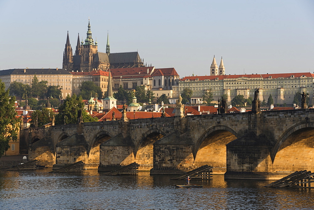 Prague Castle (Hradčany), Mala Strana, and Charles Bridge lit by sunrise, Prague, Czech Republic