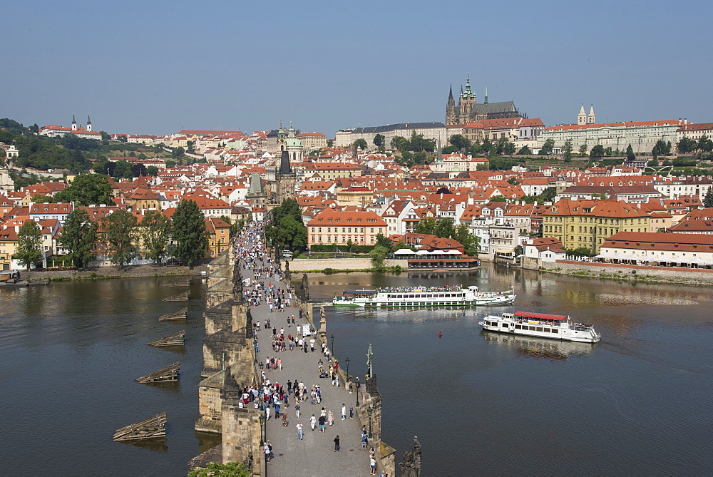 View of Charles Bridge from Old Town Bridge Tower looking toward Mala Strana and Prague Castle, UNESCO World Heritage Site, Prague, Czech Republic, Europe