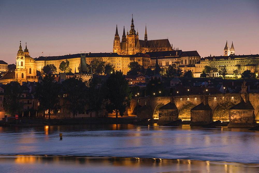 Prague Castle, Charles Bridge, Malá Strana, and the Vltava River at twilight, Prague, Czech Republic